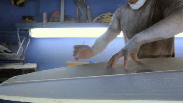 Man making new surfboard