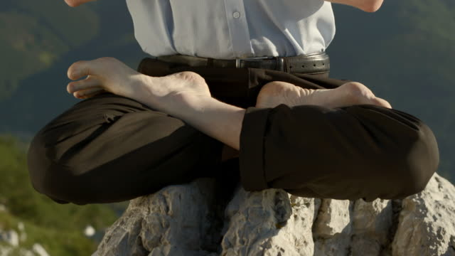 HD DOLLY: Man Meditating On The Cliff