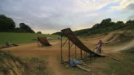 A man motocross motorcycle riding and doing a jumping trick. - Slow Motion