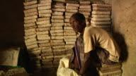 Man next to salt blocks showing salt from a sack