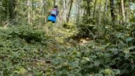TU Man on a run through the forest