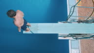 Man on diving board