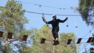 Man on High Ropes course