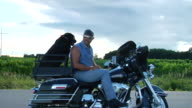 MS ZO T/L Man on motorcycle parked on roadside with dog on back/ ZI WS Man on motorcycle with dog/ Appleton, Wisconsin