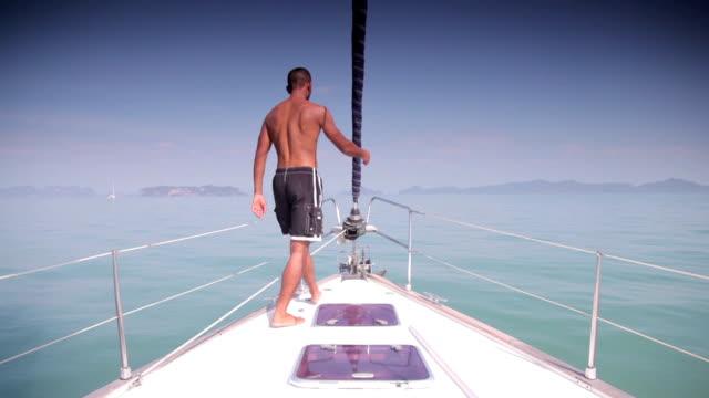 Man on Sail Yacht at Sea