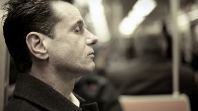 Man on subway train