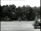 1939 WS man on tractor plowing field / Savannah, Georgia, USA