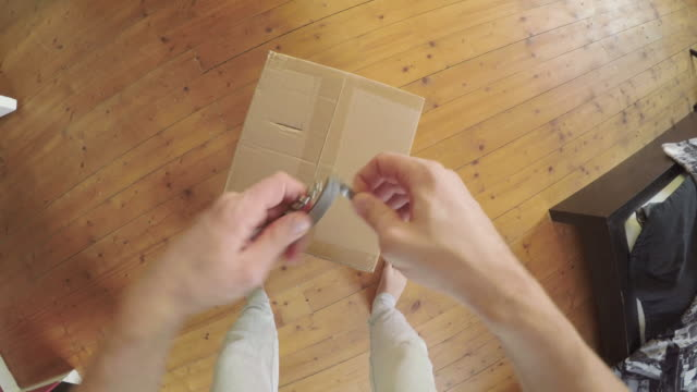 Man opening a package POV