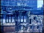 1973 MONTAGE CU Man operating crane levers/ WS ZI Wrecking ball demolishing building/ MS Crane operator/ MS Wrecking ball falling on concrete/ TU Demolished building/ USA/ AUDIO