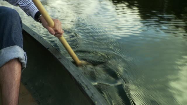 CU TU Man paddling canoe on lake, Morristown, Vermont, USA