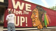 WGN Man Painting Blackhawks Mural After Stanley Cup Win on June 17 2015 in Chicago Illinois