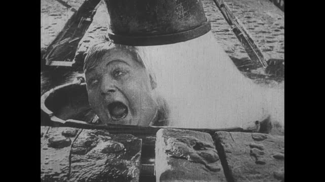 Fatty Arbuckle panics when the conductor fills the tank with more water