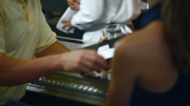 MS Man paying bill at bar / Seattle, Washington, USA