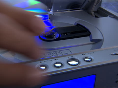 Man Placing CD in CD Player