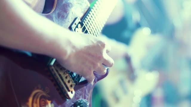 CU : Man Playing A Guitar At A Rock Concert