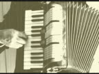 Man playing accordion with live sound and retro ambient