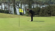 MS, Man playing golf, Kinsale, Ireland