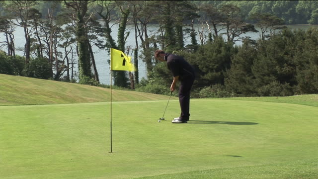 MS, Man playing golf, Kinsale, Ireland