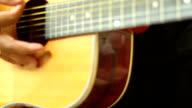man playing guitar close up