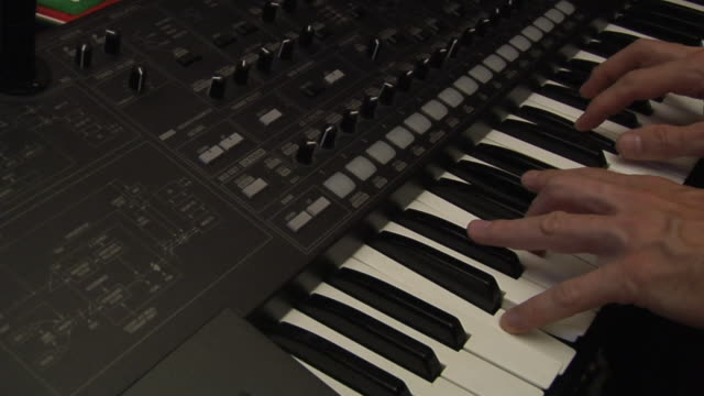 FAST MOTION, CU, Man playing synthesizer, close-up of hands
