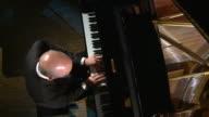 HD CRANE: Man Playing The Grand Piano