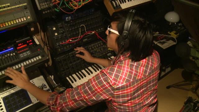 MS HA man playing various keyboards in recording studio, Gent, Belgium
