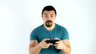 Man playing video games with a gamepad or joystick getting angry for losing the game