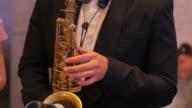 A Man plays a saxophone