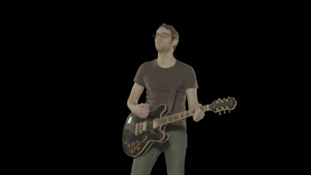 Man plays guitar. Isolated clip alpha channel available in 4k version