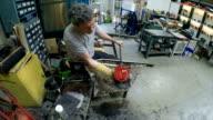 Man polishing glass object