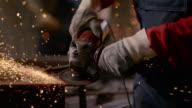 SLO MO DS Man polishing metal