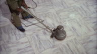 MS Man polishing white marble floor by polishing machine / Unspecified