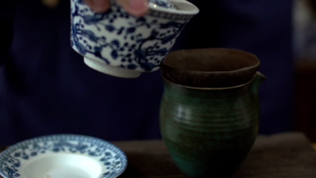 Man pouring tea into cup,Slow Motion