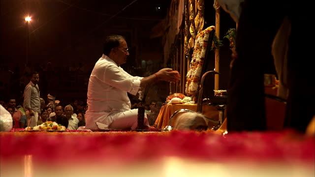 A man prays at an altar.