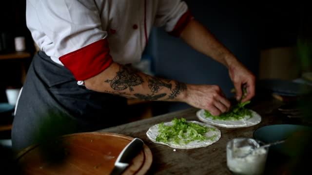 Man preparing burrito