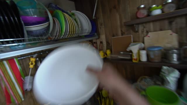 POV of man preparing eggs for breakfast in the kitchen