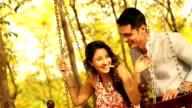 MS Man pushing girlfriend on swing and enjoying in park / Delhi, India
