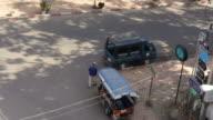 Man pushing Tuk Tuk away in Vientiane, Laos