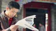 CU man read newspaper/xian,shaanxi,China