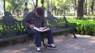 Man reading newspaper at a Park in Mexico