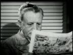 1948 MONTAGE man reading newspaper / United States