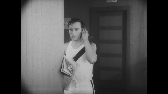 Buster Keaton receives the popular girl's call for help
