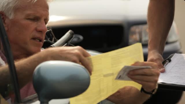 CU, Man Receiving Traffic Ticket from Police Officer, Eastville, Virginia, USA