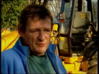 Man removes speed hump ITN Lorry towards and past over speed hump PAN MS Another lorry towards and past Beesley's house PAN Ian Beesley interview SOT...
