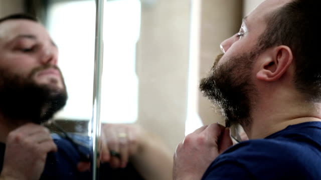 Man removing beard