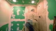 T/L, MS,  Man renovating bathroom