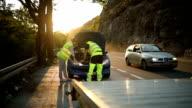 Man repairing car on the road