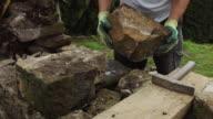 Man Repairing Dry Stone Wall