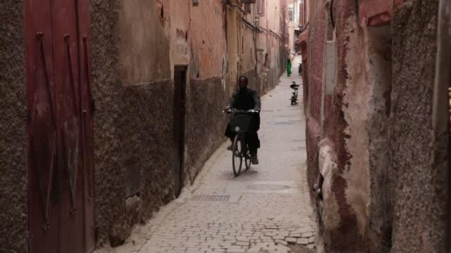 man rides bike