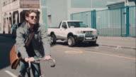 Man riding bike in urban setting